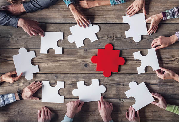 Hipster business successful teamwork concept  business group assembling jigsaw puzzle